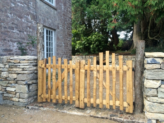 cleft chestnut picket gates with blue limestone dry walls