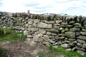 granite dry stone wall with overhanging coping