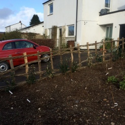 Woven hazel and cleft chestnut fence