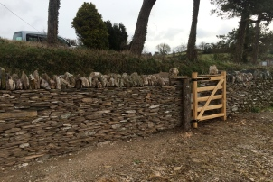 Slatey dry stone wall repair