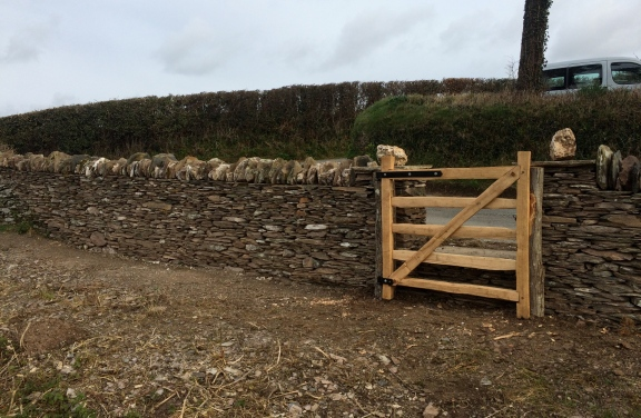 The finished dry stone wall repair