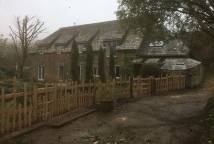 Chestnut fence with alternating pickets